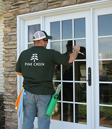Cleaning Glass on French Entry Door.